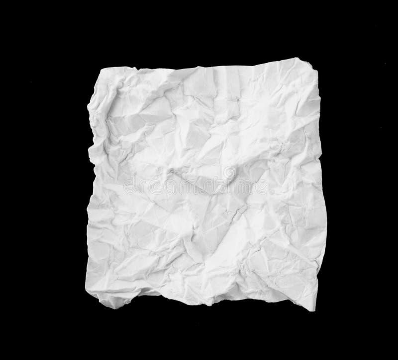 Weiße gebrochene und gefaltete Papieranmerkung lokalisiert auf einem schwarzen backgrou lizenzfreies stockfoto