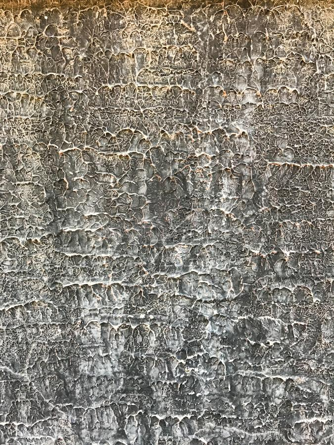 Weiße graue gewellte Linien Hintergrundmusterbeschaffenheit auf der Zementwandoberfläche, Detailhintergrunddesign-Nahaufnahmezusa stockfoto