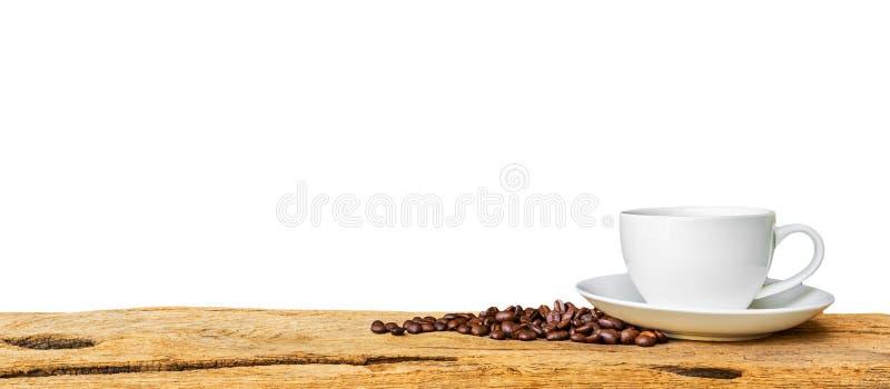 Weiße Kaffeetasse auf hölzerner Tabelle stockfoto