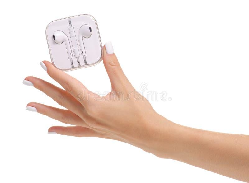 Weiße Kopfhörer in der Hand stockfotografie