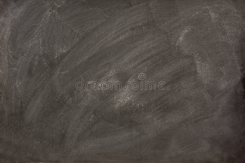 Weiße Kreideschmierstellen auf einer Tafel lizenzfreie stockbilder