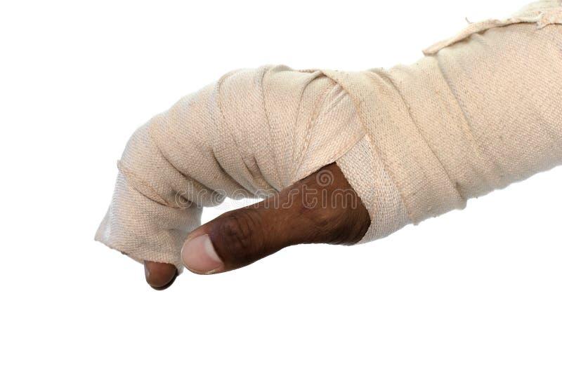 Weiße Medizinverband-Verletzungshand auf weißem Hintergrund lizenzfreie stockfotografie