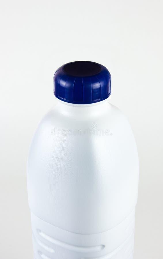 Weiße Milchflasche stockbild