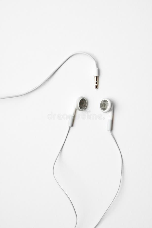 Weiße Ohrtelefone stockfotografie