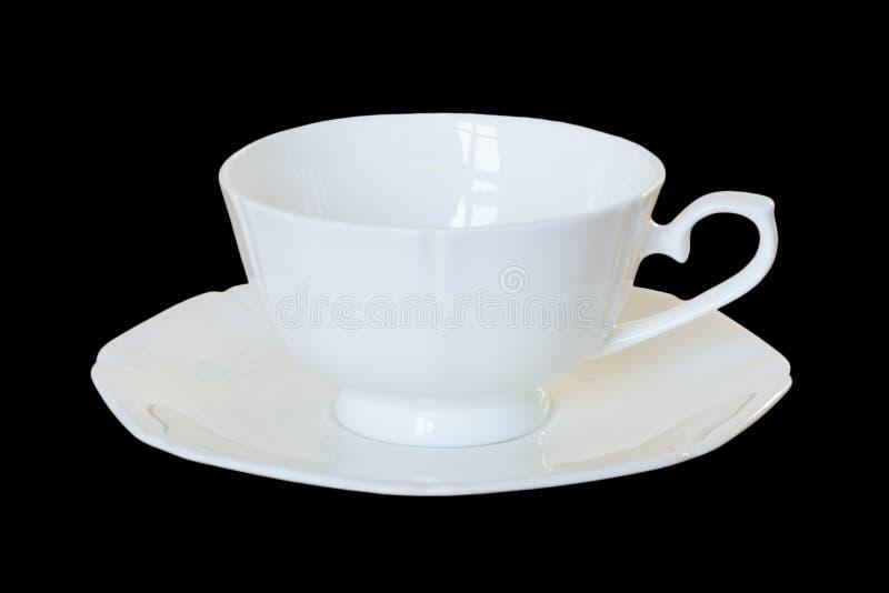 Weiße Porzellanschale mit einer Untertasse für Tee oder Kaffee stockfotografie