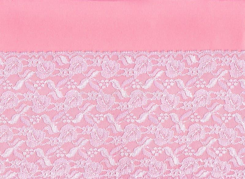 Weiße Spitze auf rosafarbenem Hintergrund. lizenzfreie stockfotografie