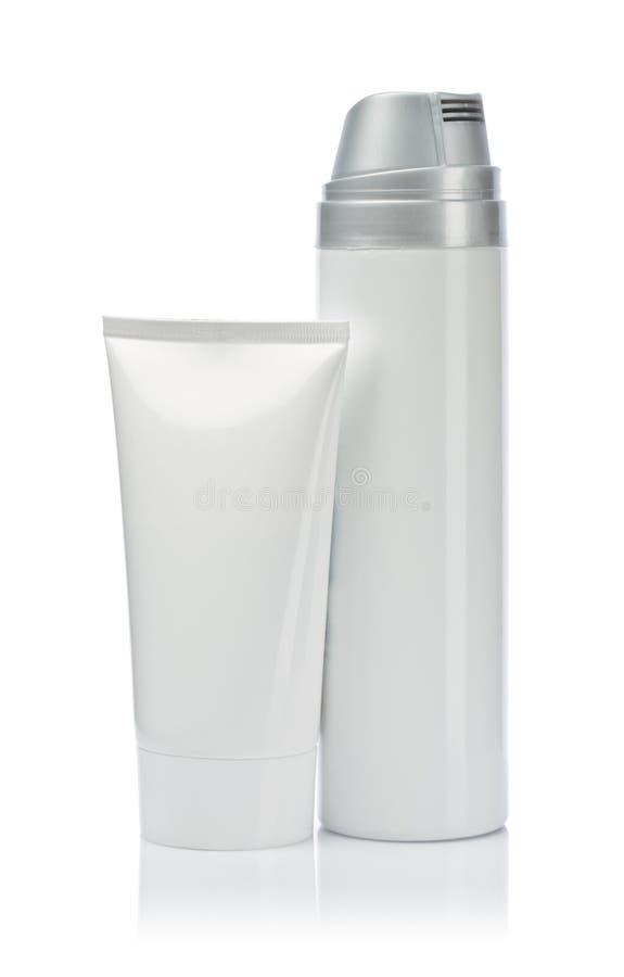 Weiße Sprayflasche und weißes Gefäß stockfotografie