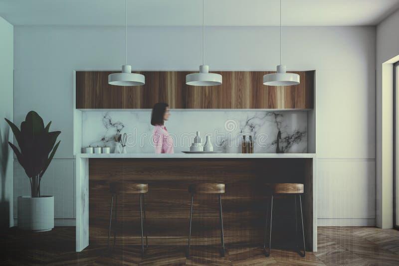 Weiße Stange in einem grauen Kücheninnenraum, Frau lizenzfreie stockbilder