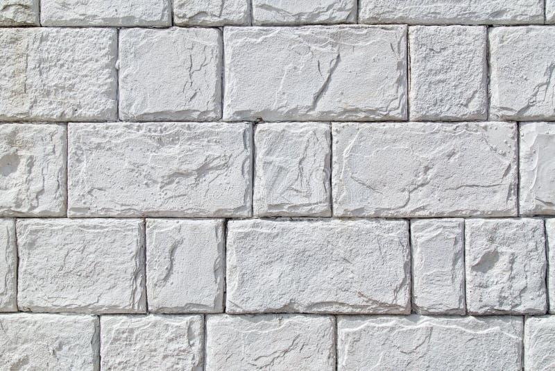 Weiße Steinwand als Hintergrund stockbilder