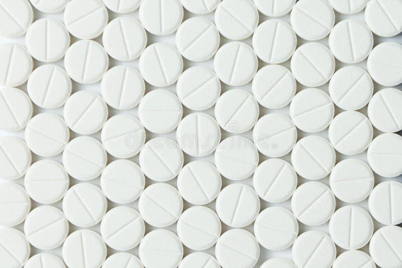 Weiße Tabletten oder Medizin stockbilder