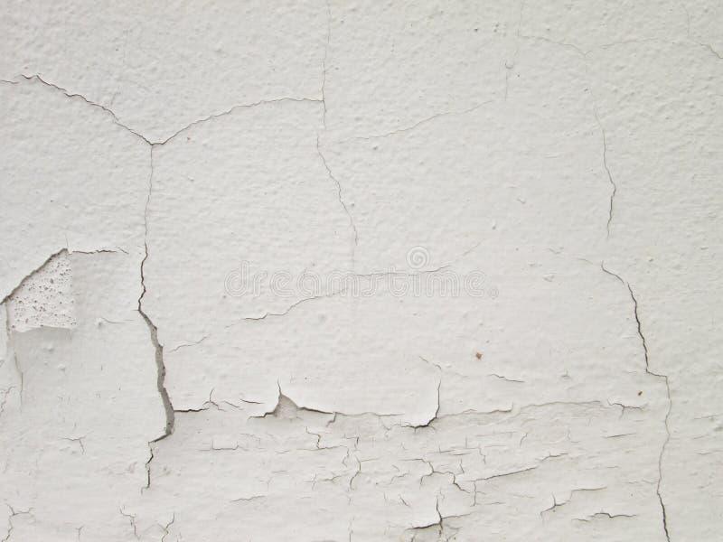 Weiße Wand mit Sprüngen lizenzfreie stockbilder