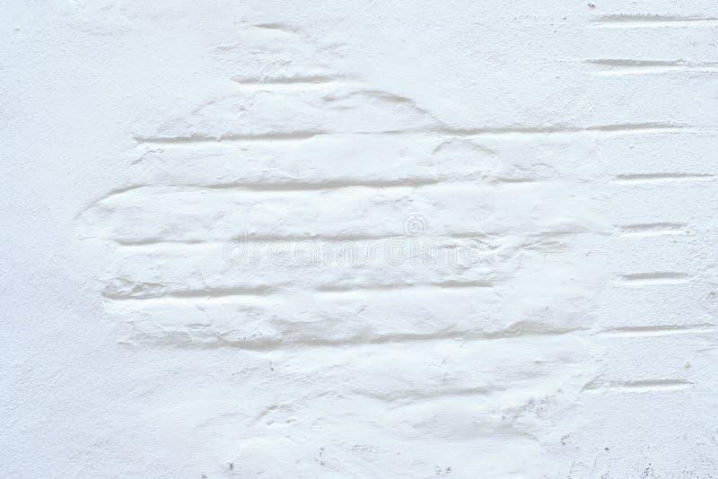 Weiße Wand mit Ziegelsteinen lizenzfreie stockfotos