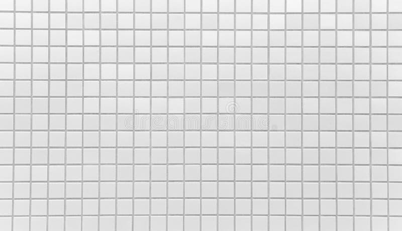 Weiße Ziegelsteinfliesenwandbeschaffenheit und -hintergrund stockfotos