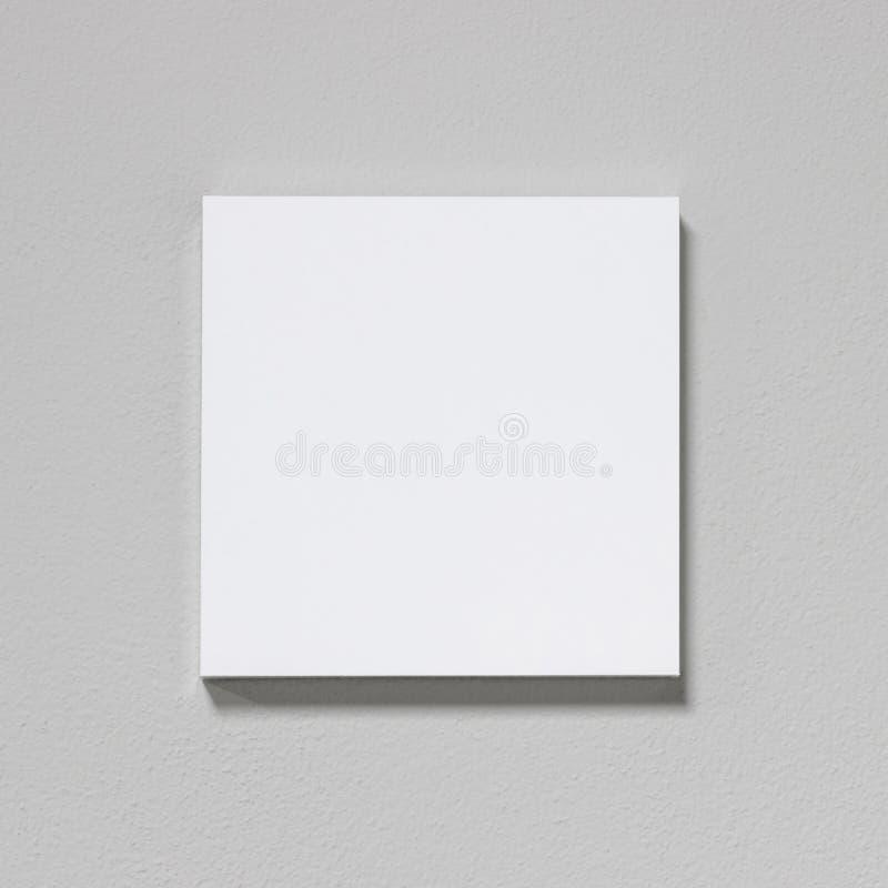 Weißer Bilderrahmen auf Zementwand Moderne Galerie in der einfachen Art stockbild