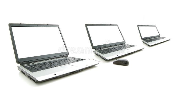 Weißer Bildschirm in Laptop drei lizenzfreie stockbilder