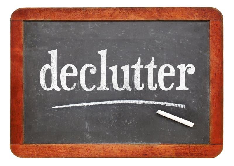 Weißer Kreidetext Declutter auf Tafel lizenzfreies stockfoto