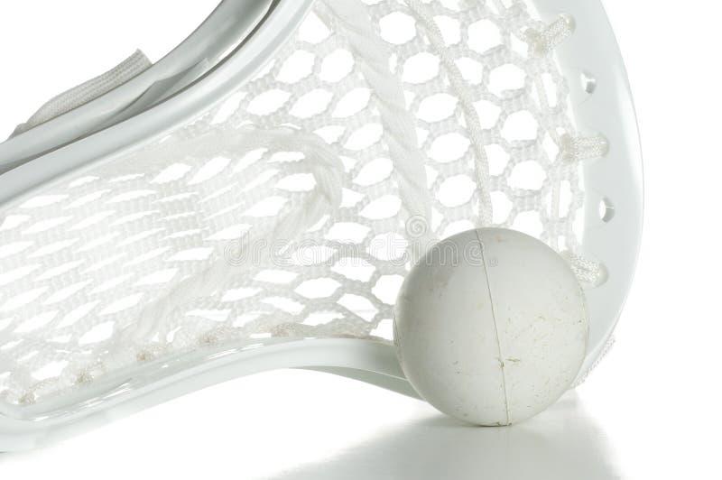 Weißer Lacrosse-Kopf mit Kugel stockbilder