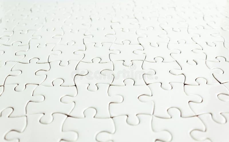 Weißer Puzzlehintergrund lizenzfreies stockfoto
