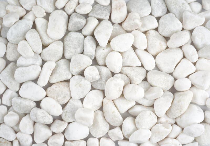 Weißer Steinhintergrund schöne weiße Kopfsteinbeschaffenheit stockfotografie