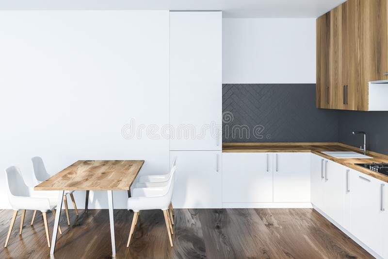 Weißer und grauer Kücheninnenraum mit Tabelle lizenzfreie abbildung