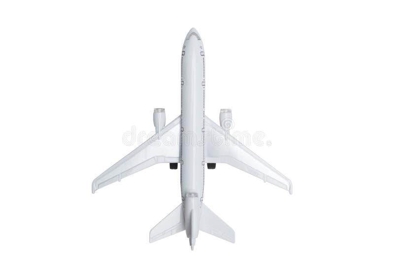 Weißes Dreimaschinenbreitkörperjet-Passagierflugzeugspielzeug lokalisierte stockfoto