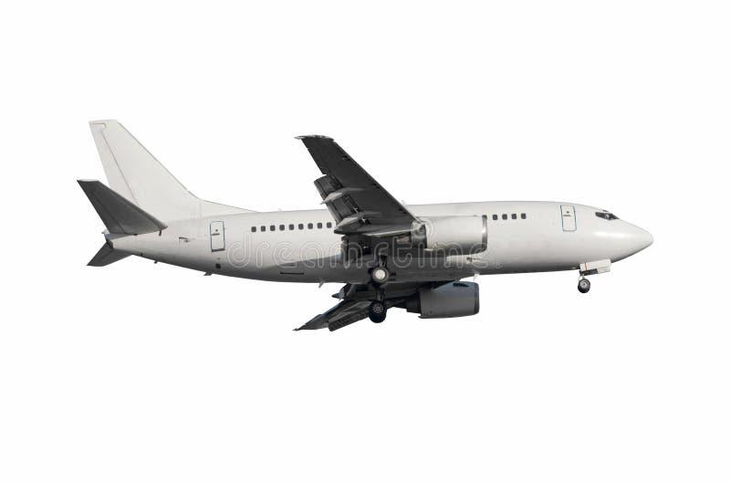 Weißes Flugzeug bereit zum Landungsfliegen lokalisiert lizenzfreies stockfoto