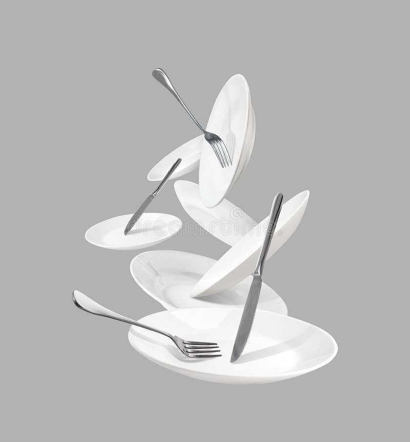 Weißes Küchengeschirr mit Gabeln und Messern vektor abbildung