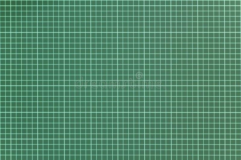 Weißes kariertes Muster auf einem grünen Hintergrund der Schneidematte Raue Oberfl?chen-Beschaffenheit lizenzfreie stockfotos