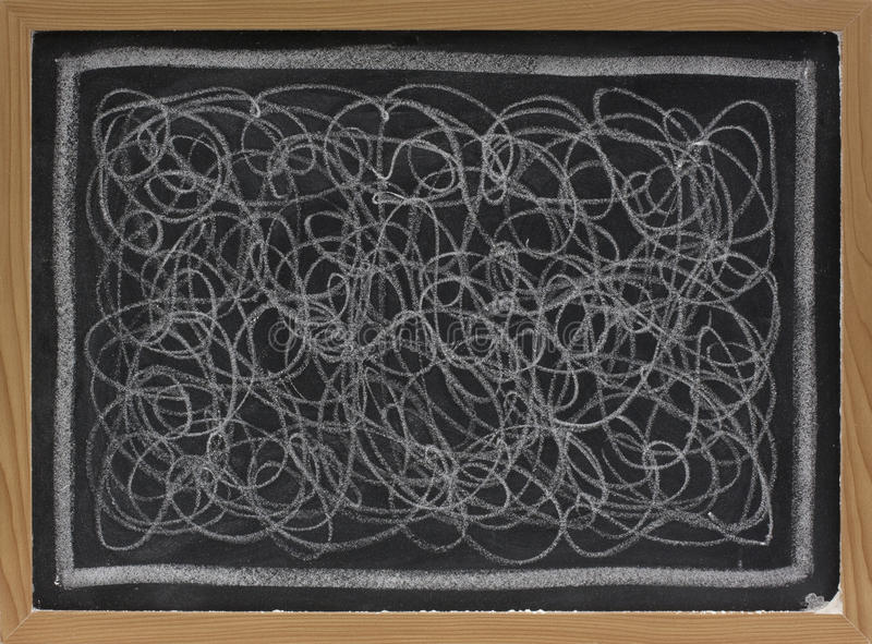 Weißes Kreidegekritzel auf Tafel stockfotografie