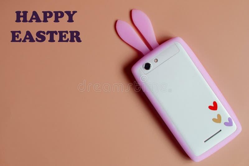 Weißes Telefon mit den rosa Häschenohren lizenzfreie stockfotografie
