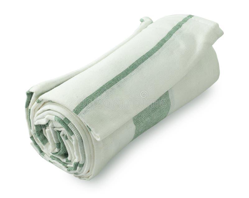 Weißes und grünes Geschirrtuch auf weißem Hintergrund stockfotografie