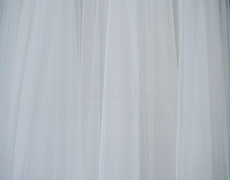 Weißes weiches Tulle-Gewebe Interessanter strukturierter Hintergrund mit Kopienraum lizenzfreies stockfoto