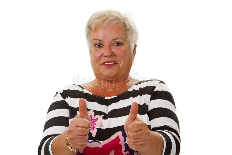 Weibliche ältere Daumen oben stockfotos