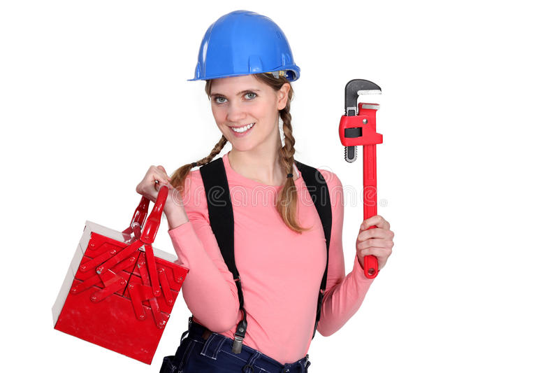 Weibliche Arbeitskraft mit einem Werkzeugkasten. stockbild