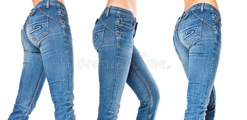 Weibliche Fahrwerkbeine in Blue Jeans stockfotografie