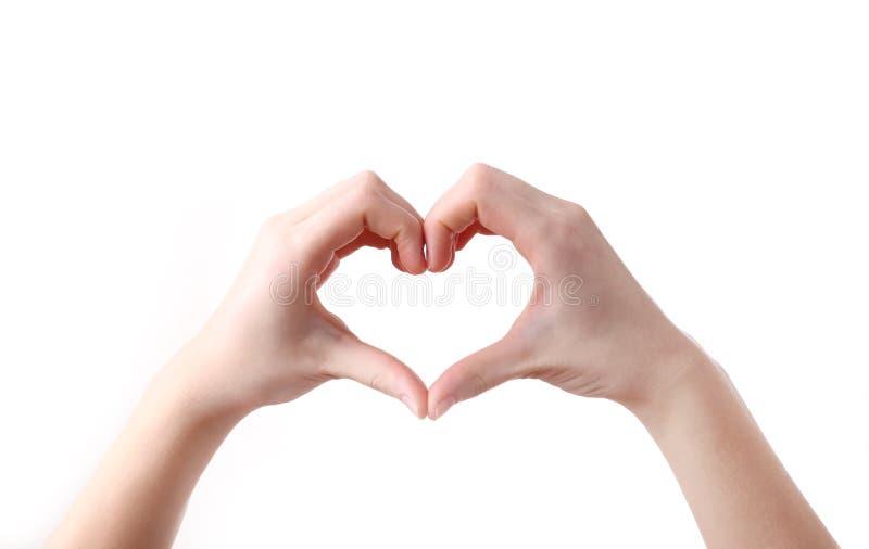 Weibliche Hände in der Herzform auf weißem Hintergrund stockbild