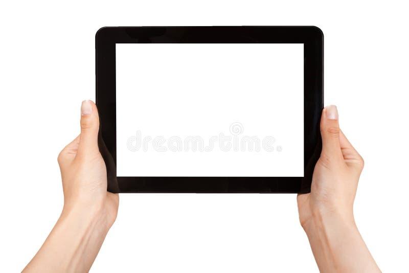 Weibliche Hände, die eine Tablette halten stockfoto