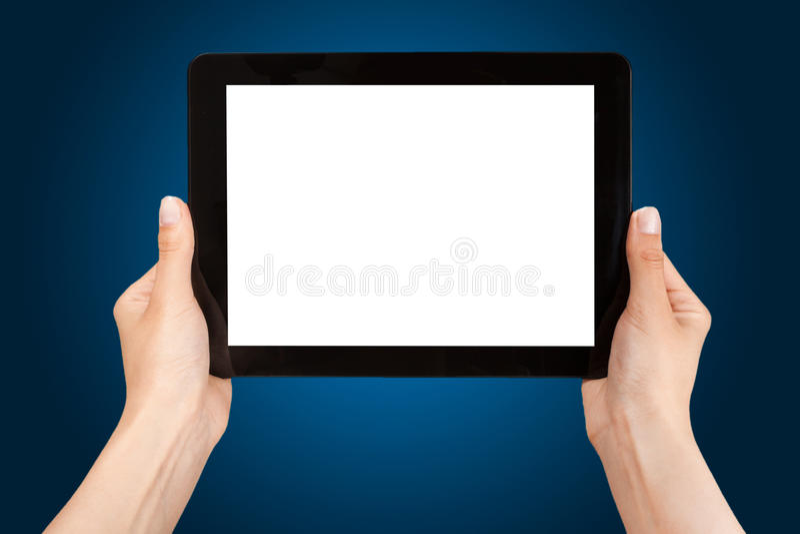 Weibliche Hände, die eine Tablette halten lizenzfreies stockbild