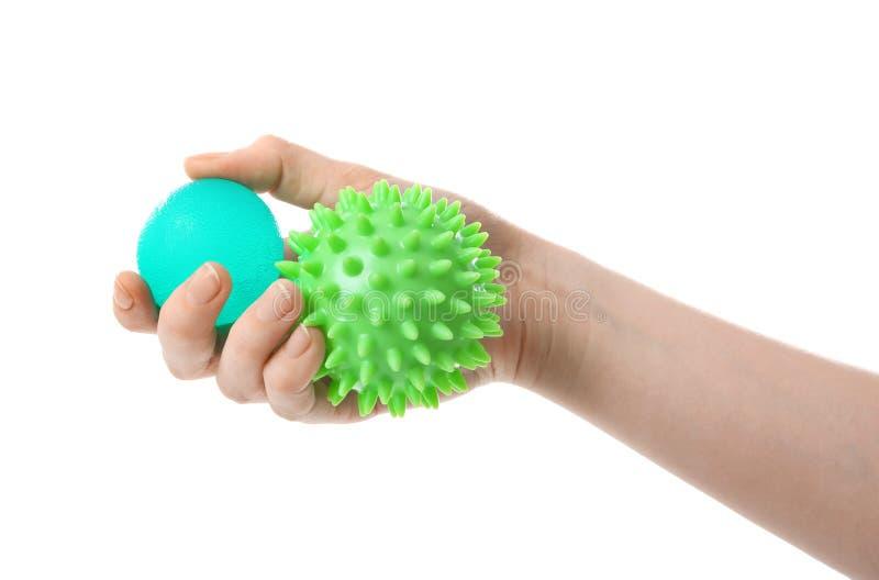 Weibliche Hand mit Druckbällen lizenzfreies stockfoto