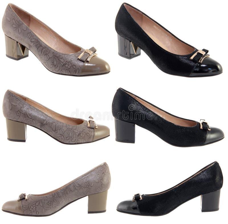 Weibliche Schuhe auf einem weißen Hintergrund lizenzfreies stockfoto
