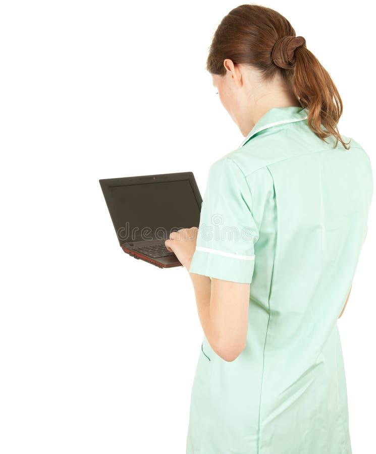 Weiblicher Arzt mit Laptop stockbild