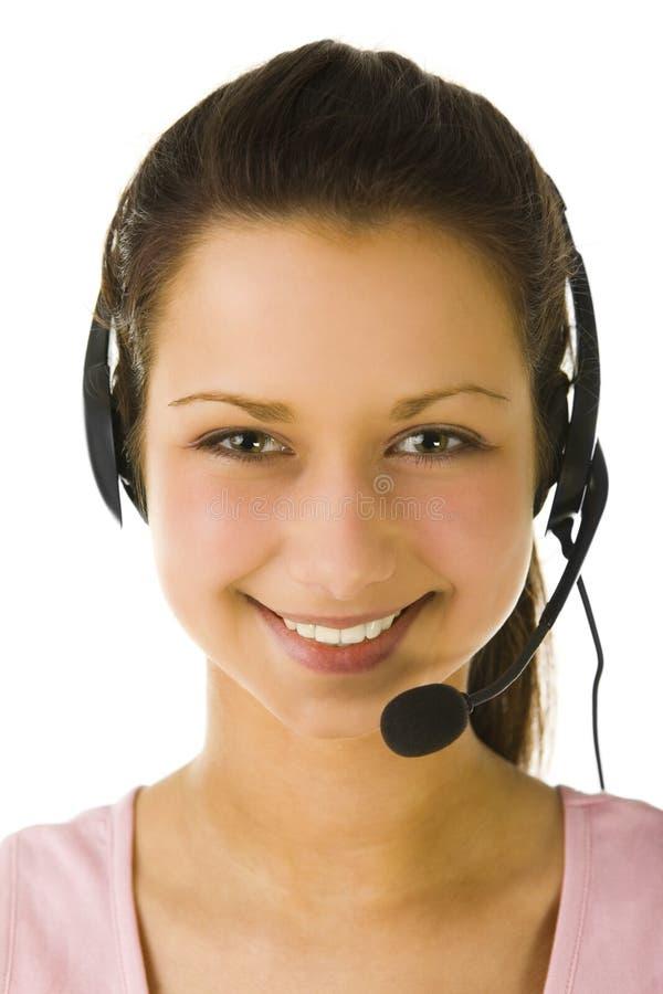 Weiblicher Bediener mit Kopfhörer stockfoto
