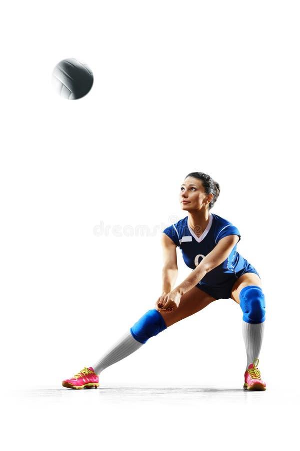 Weiblicher Berufsvolleyballspieler auf Weiß stockfoto