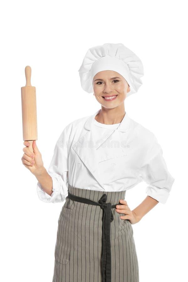 Weiblicher Chef, der Nudelholz hält stockfoto
