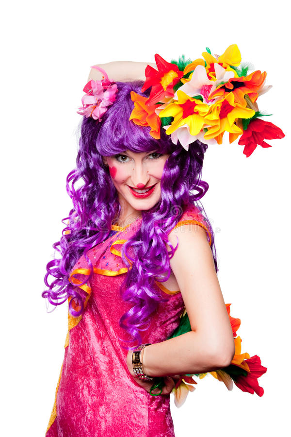 Weiblicher Clown mit bunten Blumen lizenzfreies stockbild