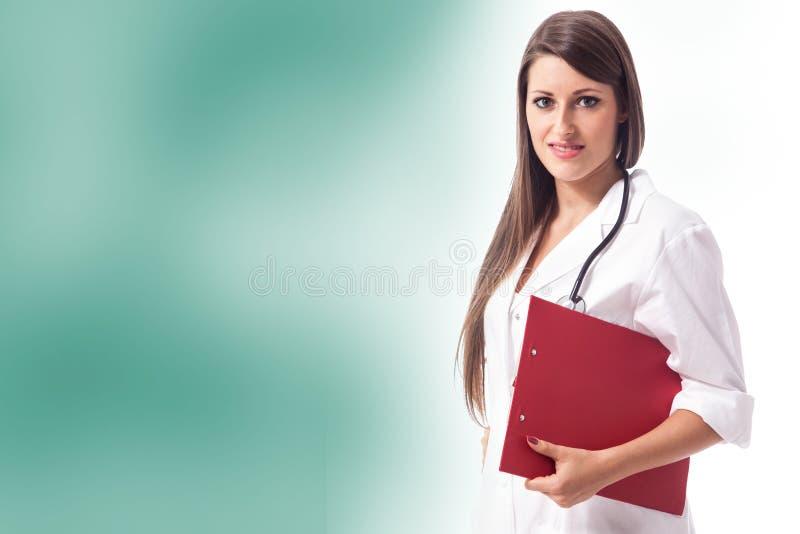 Weiblicher Doktor auf buntem Hintergrund stockbild