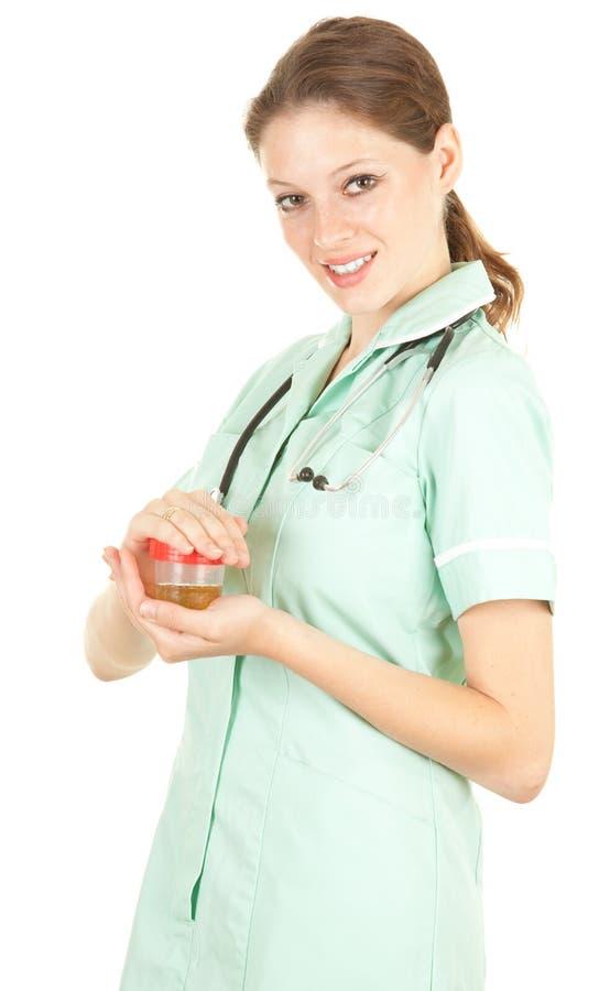 Weiblicher Doktor, der Urin zur Analyse hält lizenzfreies stockfoto
