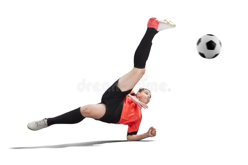 Weiblicher Fußballspieler im orange einheitlichen Herstellungsfahrradtritt lokalisiert stockfotografie
