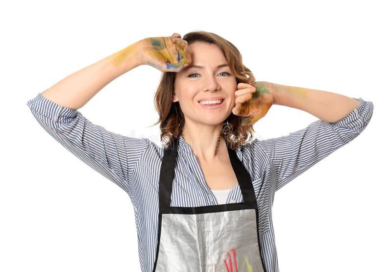 Weiblicher Künstler mit den gemalten Händen auf weißem Hintergrund stockfotografie
