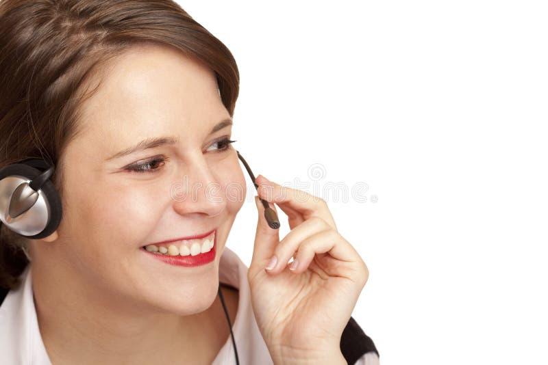 Weiblicher Kundenkontaktcenterbediener benennend freundlich lizenzfreie stockfotografie
